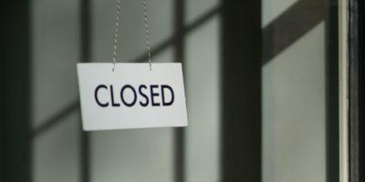 Closed sign outside a dormant premises