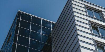 office building against a blue sky backdrop